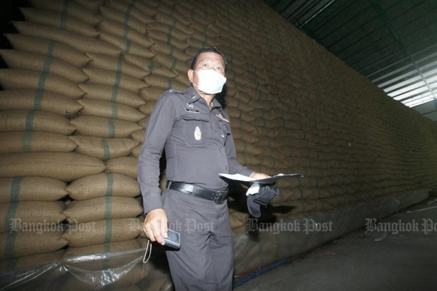 Authorities check the quality of rice stocks kept at a warehouse in Bangkok, as the cabinet was passing a proposed amendment aiming to ban future populist programmes like the rice-purchase scheme of Pheu Thai. (Photo by Seksan Rojjanametakun)