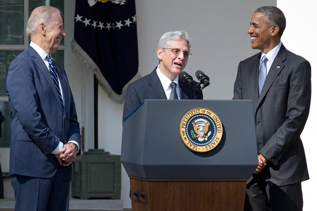 President Barack Obama and Vice President Joe Biden look on as Merrick Garland, Mr Obama's nominee for the Supreme Court vacancy, speaks during his rose garden announcement ceremony, at the White House in Washington, March 16. Mr Garland is currently chief judge for U.S. Court of Appeals D.C. Circuit. (New York Times photo)