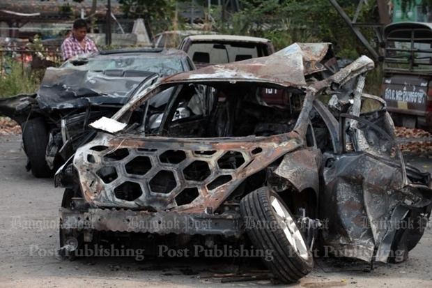 The burned out remains of the Ford hatchback in which two graduate students died after being hit by a Mercedes-Benz travelling in excess of 150km/hour.  CHANAT KATANYU