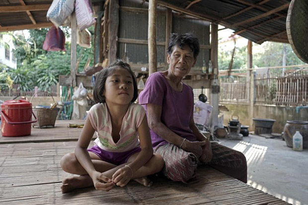 Eight-year-old Thai girl Chayanit (left) sits with her grandmother Chanpen Uthachan at their home in the village of Baan Dua in Ubon Ratchathani province. Chayanit and her five-year-old brother Kittipop have been raised by their grandparents for almost their entire life after their parents left their rural village to find work in Bangkok. (AFP photo)