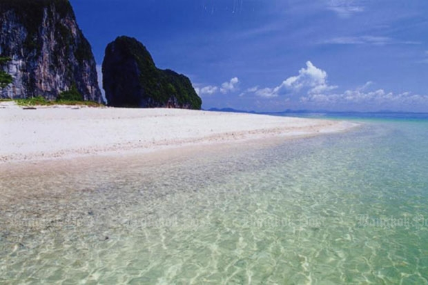 The crystal clear water and sandy beach on Laoliang, a pristine island off the coast of Trang province. (Bangkok Post file photo)