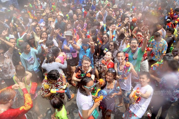 Khao San Road is jam-packed with tourists and locals as Songkran festivities reach a peak. This year the celebration will be muted because of the drought. (Bangkok Post file photo)
