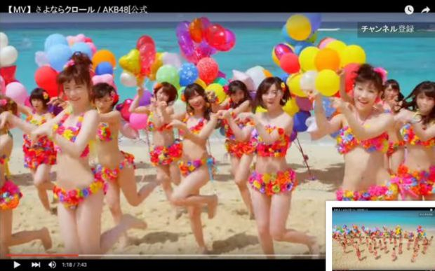 Japanese all-girl pop group AKB48 aims to get many people participating as they do in this spectacle musical performance (Source: Screen capture YouTube)