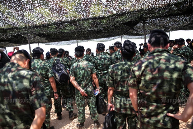 Prime Minister Prayut Chan-o-cha has empowered commissioned officers backed up by rank-and-file soldiers to act as crime suppression officers. (Photo by Wichan Charoenkiatpakul)
