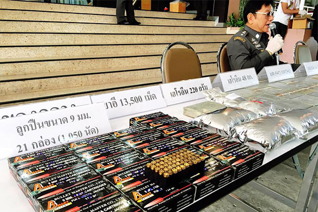 A total of 48 kilogrammes of compressed heroin, 13,500 ecstasy pills and 1,050 rounds of 9mm ammunition seized from four accused drug traffickers are displayed during a media briefing at the Narcotics Suppression Bureau on Saturday. (Photo taken from the NSB Facebook page)