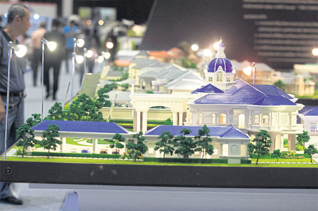 Models of luxury houses are on display at a house and condo fair held in Bangkok. Homeowners' tax burden will not be any heavier with the new land and buildings tax, the government says.PAWAT LAOPAISARNTAKSIN