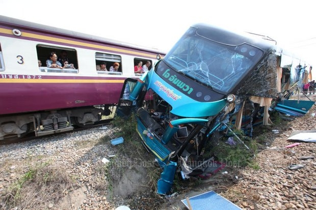 Passengers observe the bus struck by their train in yet another deadly crossing