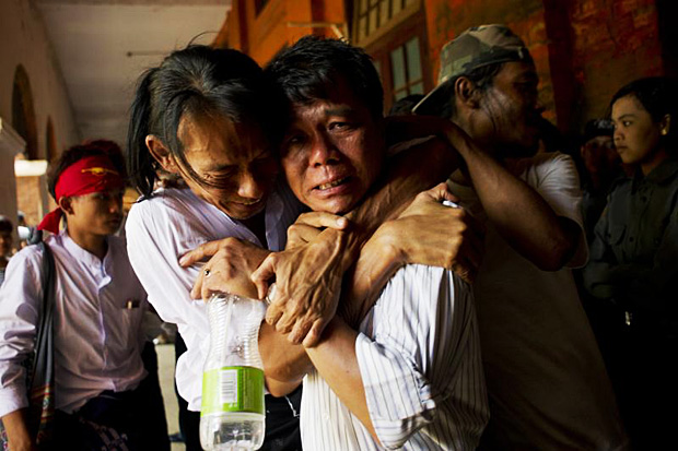 Newly-released political student protester and family members cry after being reunited in Tharrawaddy town, Bago region in Myanmar on Friday (AFP photo)