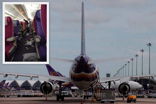An inset shows the interior of the aircraft after air turbulence on Thai Airways International flight TG434, while the plane was en route from Jakarta to Bangkok on Monday. (Post Today/Kru P'Birth Facebook photos)