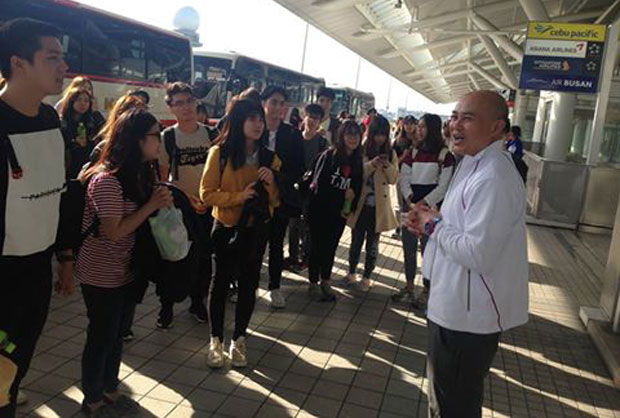A group of Thai tourists are sent to Fukuoka airport by the Royal Thai embassy, according to images posted by the Tokyo embassy's Facebook page.