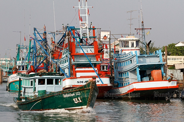 "Fishing boats tie up in a harbour in Phetchaburi Feb 16. The EU will leave in place its ""yellow card"" on Thailand's seafood industry due to continuing concerns over fisheries and labour practices. (Photo by Thanarak Khunton)"