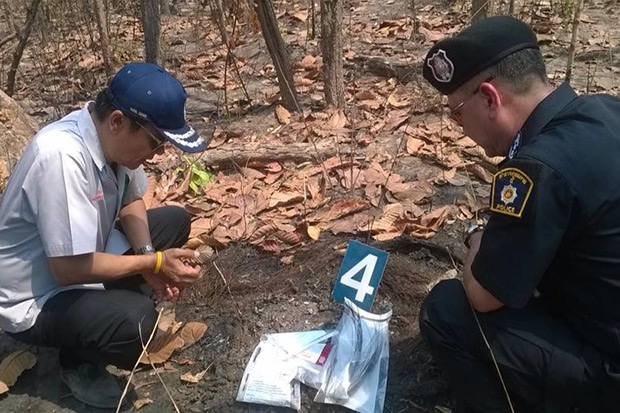 Authorities inspect human bones found in a forest in Udon Thani on Thursday. (Udon Thani governor Chayawut Chanthorn's Facebook page)