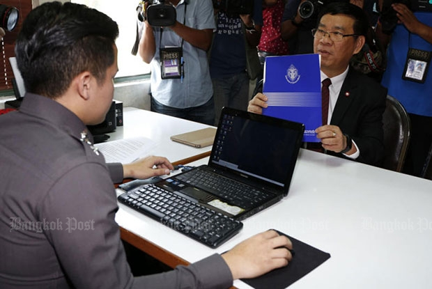 "Election commissioner Somchai Srisuthiyakorn on Wednesday files charges against an unnamed Facebook group for a ""foul and harsh"" critique of the draft constitution. (Photo by Pattarapong Chatpattarasill)"