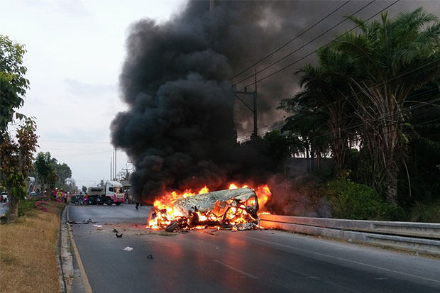 A passenger van is engulfed in flames following a fatal crash involving the van, a pickup truck and a motorcycle in Nakhon Si Thammarat's Tha Sala district on Wednesday evening, which killed four van passengers and injured seven others. (Photo by Nujaree Rakrun)