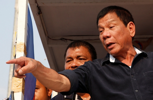 Presidential candidate Rodrigo Duterte greets supporters during a rally in Malabon, Metro Manila. (Reuters Photo)