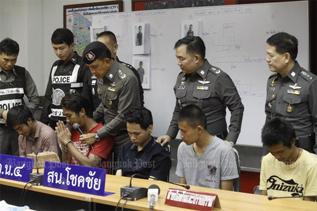 Police bring five of the suspects to a briefing on Saturday while another remains in hospital. All six were charged with beating and killing a 36-year-old disabled man with knives and rocks on May 1. (Photo by Pornprom Satrabhaya)