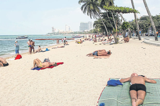 Foreign tourists sunbathe at a beach in Pattaya, a top spot among Russian visitors. Thailand expects to welcome 1 million Russian tourists this year thanks to a strengthening rouble.NATTAPOL LOVAKIJ