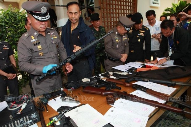 Police display various types of firearms confiscated during a crackdown on 'dark influence' in Samut Prakan. Several licenced items belong to Pheu Thai politicianPracha Prasopdee but authorities confiscated them to see if they had been used in any crimes. (Photo by Somchai Poomlard)