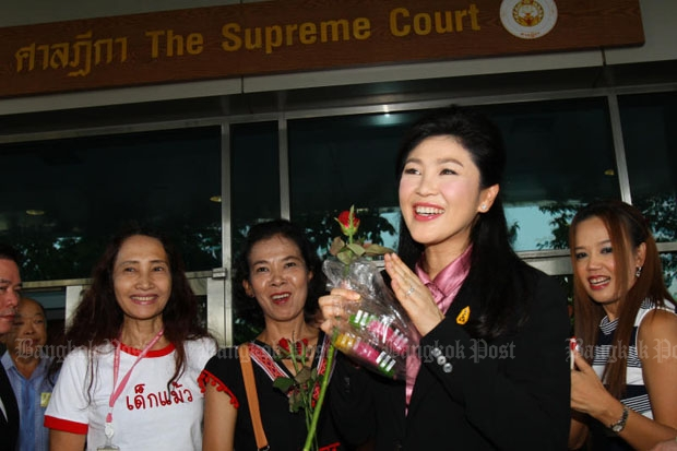 Former prime minister Yingluck Shinawatra arrives at the Supreme Court in Laksi district of Bangkok on Friday to hear testimony in her trial for alleged dereliction of duty in her government's rice-pledging scheme. (Photo by Tawatchai Kemgumnerd)