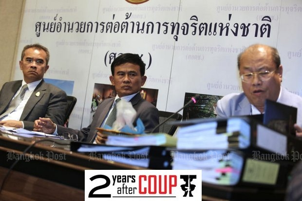 Justice MinisterGen Paiboon Koomchaya (centre) is leading efforts to reform the judicial system, but there still are at least 19 more draft legal amendments and new bills in the pipeline. (Photo by Pattanapong Hirunard)
