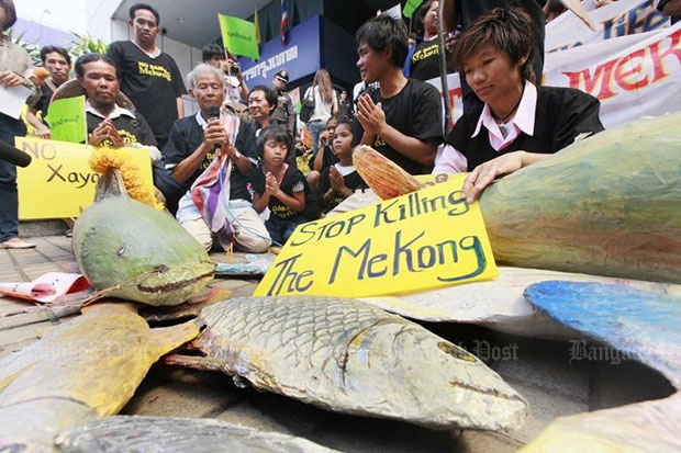 Protesters who fear the Xayaburi dam on the Mekong River in Laos will ruin the fisheries sector demonstrate in Bangkok in April 2012. (Bangkok Post file photo)
