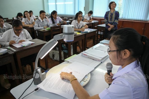 A teacher monitors her English language class at Chetupon Commercial College, which is preparing students for the Asean Economic Community. (Photo by Panupong Changchai)
