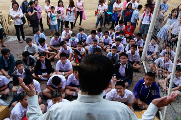 Students and parents listen to a briefing from a teacher on admission day at Suankularb Wittayalai School for boys, a leading public school in Bangkok, in March this year. (Bangkok Post file photo)