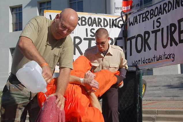 HIGH PRICE FOR FREEDOM: The waterboarding interrogation technique is demonstrated during a protest against torture. (AP photo)