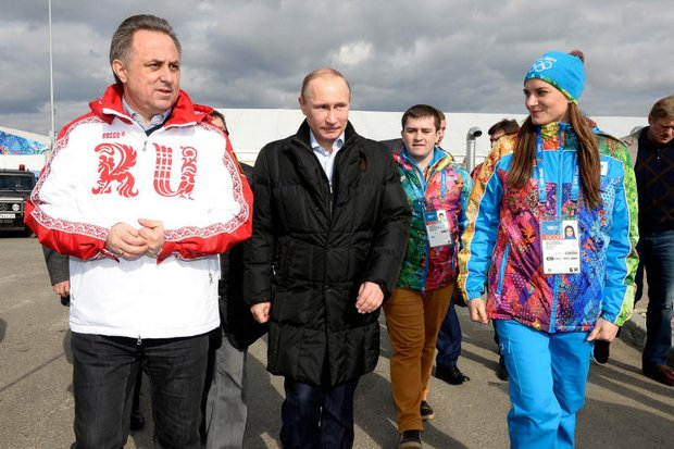 Russian President Vladimir Putin, flanked by Sports Minister Vitaly Mutko (left) and then-Olympic village mayor and pole vaulter Yelena Isinbayeva visit 2014 Winter Olympics site in Sochi. Mr Mutko says Russia is