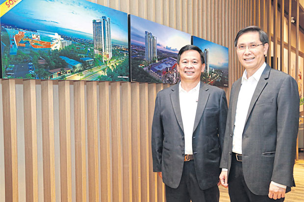 Chief executive Preecha Ekkunagul (right) and Kree Dejchai, executive vice-president of special project development, at the launch of Escent Residence Condominium.