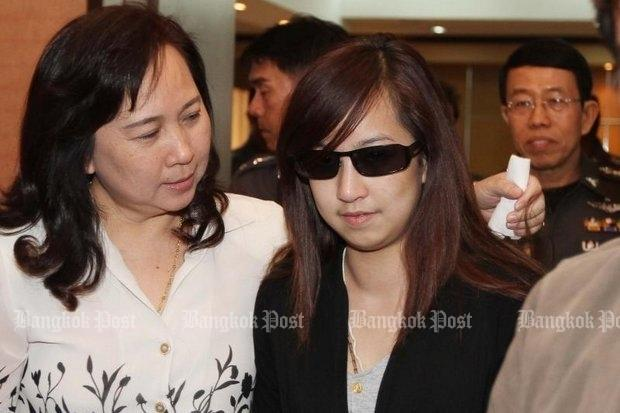 """Along with her attentive mother, Orachorn """"Praewa"""" Thephasadin na Ayudhya reports to police in early 2011, 10 days after she caused a fatal tollway crash. (Bangkok Post file photo)"""