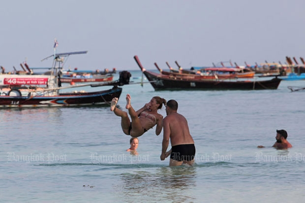 Tourists enjoy the water off Koh Lipe in Satun in southern Thailand. One of the first impacts on Thailand of the Brexit vote could be a drop in the number of UK tourists if they see their pound sterling buying far less overseas. (Photo by Wichan Charoenkiatpakul)
