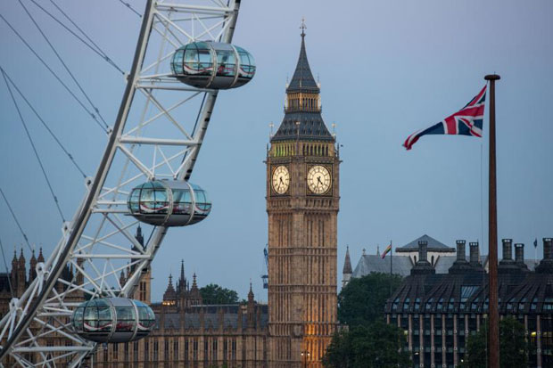 A Union flag flies beside the London Eye in front of the Queen Elizabeth Tower (Big Ben) and the Houses of Parliament in London on Friday. (AFP photo)