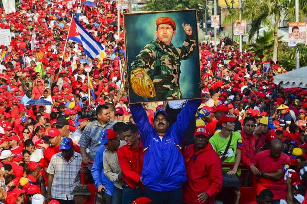 Hugo Chavez is dead but his political policies are still ruining Venezuela. (AFP photo)