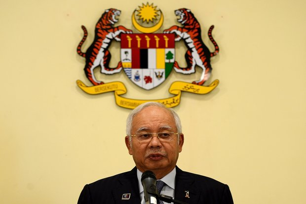 Malaysia's Prime Minister Najib Razak addresses the media following a cabinet reshuffle at his office in Putrajaya on Monday. (Photo by AFP)