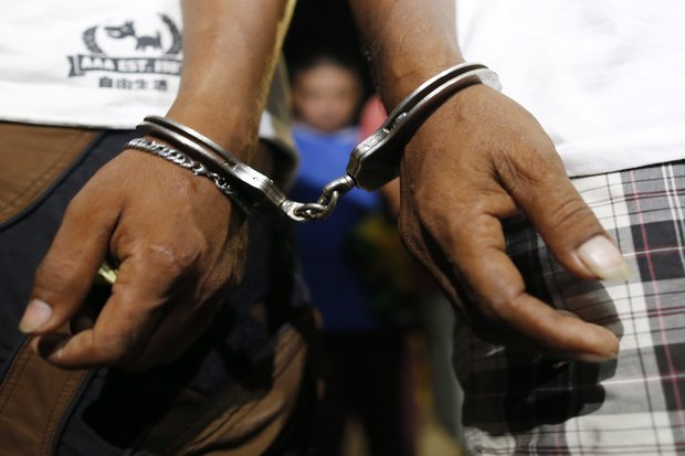 Suspected drug users and drug pushers arrested by Philippines police during a night-time raid on a suspected drug den in Manila on Tuesday. (Photo by EPA)