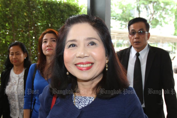 Montra Yokrattanakan, or Ying Kai, smiles as she enters Crime Suppression Division headquarters to meet investigators on Friday. (Photo by Tawatchai Kemgumnerd)