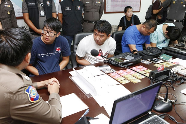 Four Taiwanese accused of being members of a credit card fraud syndicate are taken to a police briefing on Sunday. (Photo by Pattarapong Chatpattarasill)
