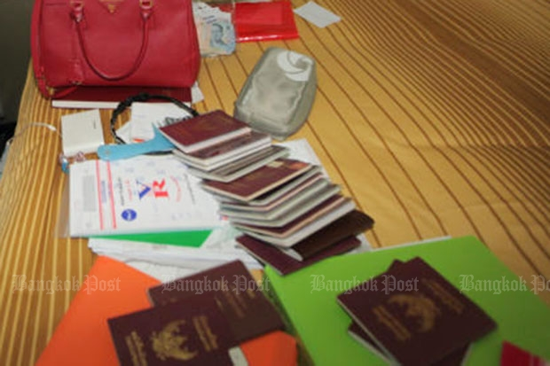 """Police are checking almost 20 passports found in a condominium room of """"Ying Kai"""
