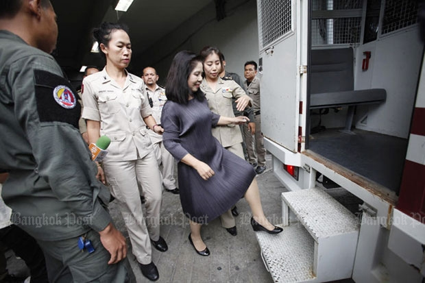 Lese majeste suspect Monta Yokrattanakan, 56, is led to a detention van to be taken to the Central Women's Correctional Institute after the Criminal Court denied her bail request. (Photo by Pornprom Satrabhaya)