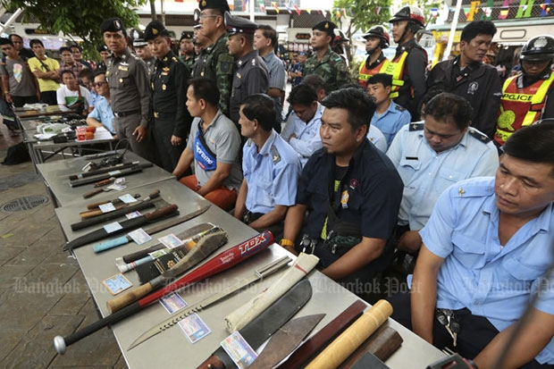 Passenger van drivers appear at a media briefing with various weapons found inside their vehicles following a search around Victory Monument in Bangkok on Friday. (Photo by Patipat Janthong)