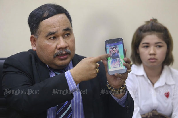 Lawyer Songkan Atchariyasap shows a picture of Soonthorn Khanhin, a driver for Monta