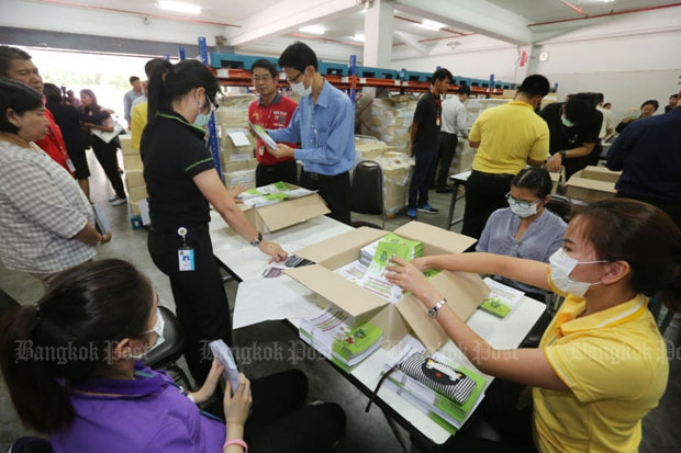 Officials are checking booklets on the main content of the draft charter before delivery at a Thailand Post office early this month. The National Council for Peace and Order expects more disorder attempts from opponents in the lead-up to the Aug 7 charter referendum. (Photo by Pattanapong Hirunard)