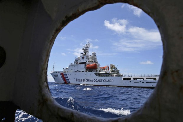 A Chinese Coast Guard ship attempts to block a Philippine government vessel as the latter tries to enter Second Thomas Shoal in the South China Sea in this March, 2014, incident. (AP photo)