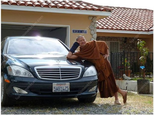 Controversial monk Phra Wirapol Sukphol, better known as Luang Pu Nen Kham Chattiko posing on a luxury car in the US.