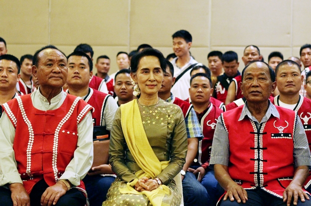 Aung San Suu Kyi sits with members of the United Wa State Army (UWSA) after a meeting of armed ethnic groups at a hotel in Nay Pyi Daw on Friday (AP Photo)