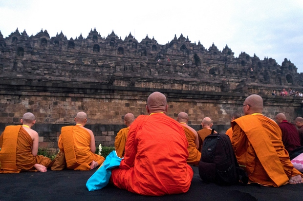 Buddhist monks from various Asian countries pray at the Borobudur Temple in Magelang, Central Java during a pilgrimage in May this year. (AFP Photo)