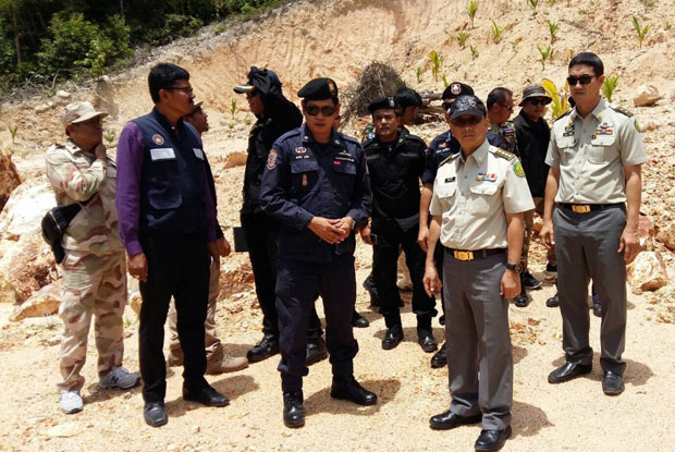 Officials inspect land believed to encroach on national forest on Koh Phangan, Sunday. (Photo: Supapong Chaolan)