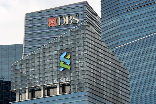 A DBS (top) and Standard Chartered bank logo (centre) are seen on the building at Marina Bay financial district in Singapore on July 21, 2016. (AFP photo)