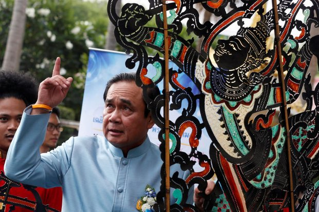 Prime Minister Prayut Chan-ocha gestures as he arrives for the weekly cabinet meeting at Government House. (Reuters photo)